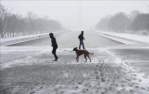 Bão tuyết gây lũ lụt diện rộng, nhiều bang của Mỹ khốn đốn - Ảnh 1.