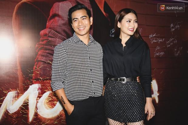 Thu Trang diện đầm hững hờ, bốc lửa đốt mắt bên Tiến Luật tại buổi ra mắt phim điện ảnh Chị Mười Ba - Ảnh 14.