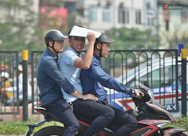 Hà Nội: Người dân, du khách nhăn mặt nhíu mày với nắng nóng 41 độ C giữa trưa hè - Ảnh 10.