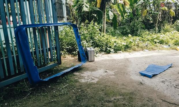 Mùi hôi nồng nặc bên trong căn nhà nơi phát hiện 2 khối bê tông chứa thi thể người ở Bình Dương - Ảnh 14.