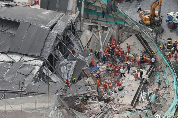 5 người chết, nhiều người bị thương trong tòa nhà đổ sập ở Thượng Hải - Ảnh 1.