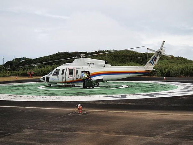 Nhật Bản: Trong miệng núi lửa đang âm ỉ vẫn có bãi đáp trực thăng và 200 người dân sinh sống - Ảnh 6.