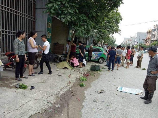 Bị taxi kéo lê, người phụ nữ bán rau tử vong thương tâm - Ảnh 1.