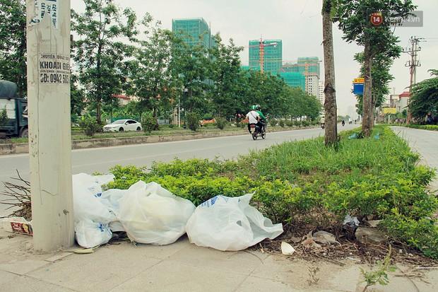 Chùm ảnh: Vừa hoạt động 3 tháng, con đường mang tên nhà tư sản Trịnh Văn Bô đã ngập ngụa rác thải - Ảnh 10.