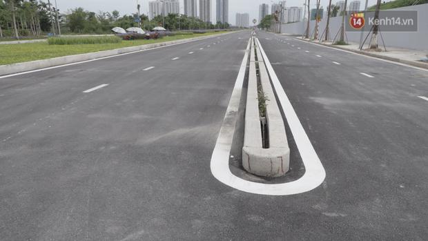 Clip, ảnh: Toàn cảnh tuyến đường mới với 8 làn xe, mạch xương sống nối liền 3 quận ở Hà Nội - Ảnh 8.
