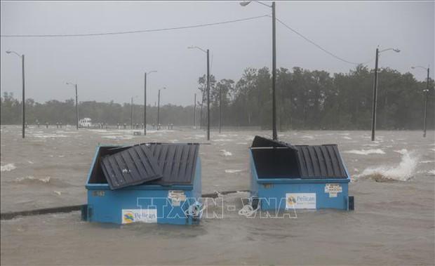 Bão Barry đổ bộ vào bang Louisiana, hàng triệu người đối mặt với lũ lụt - Ảnh 1.