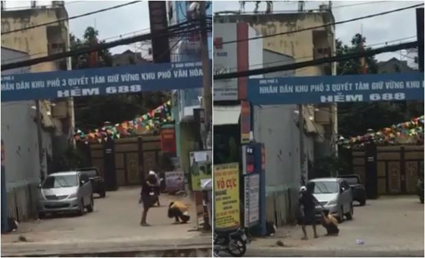 Phẫn nộ clip nam thanh niên đánh, đạp bạn gái tới tấp trên đường phố Sài Gòn - Ảnh 1.