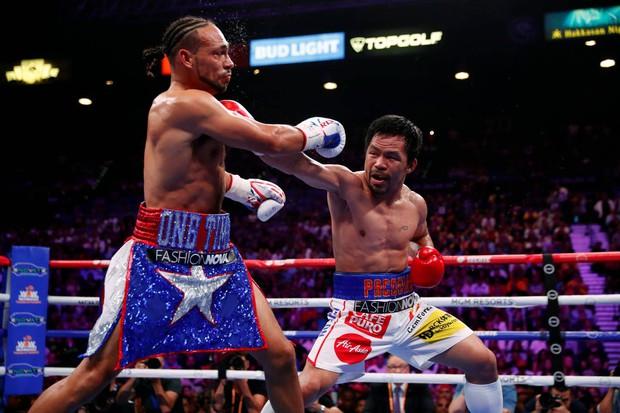 Huyền thoại Manny Pacquiao đánh như lên đồng ở tuổi 40, làm nhà vô địch bất bại người Mỹ phải câm lặng - Ảnh 2.