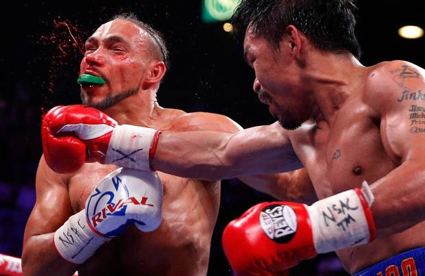 Huyền thoại Manny Pacquiao đánh như lên đồng ở tuổi 40, làm nhà vô địch bất bại người Mỹ phải câm lặng - Ảnh 7.
