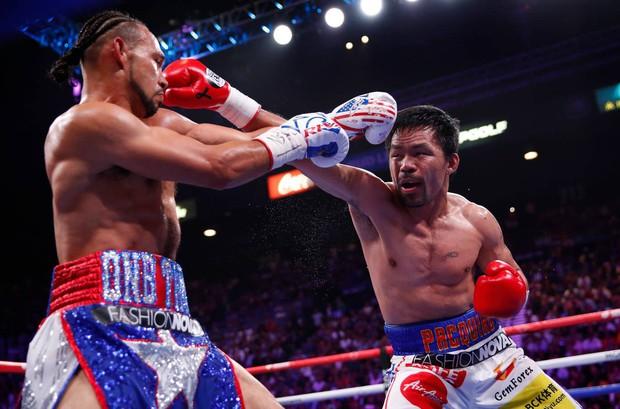 Huyền thoại Manny Pacquiao đánh như lên đồng ở tuổi 40, làm nhà vô địch bất bại người Mỹ phải câm lặng - Ảnh 3.