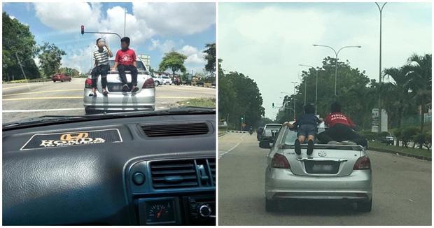 Cảnh tượng khiến người đi đường run rẩy: Tài xế cho con nhỏ đu bám trên nóc xe, lao vun vút trên đường và cái kết đáng đời - Ảnh 3.