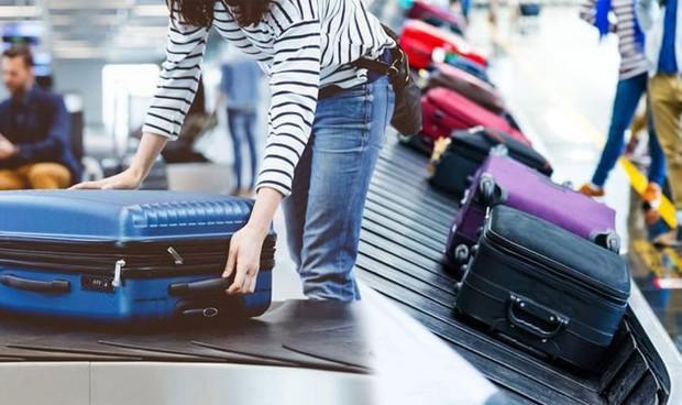 Vietnam Airlines thay đổi cách tính hành lý, điểm khác biệt ra sao giữa hệ cân và hệ kiện? - Ảnh 2.