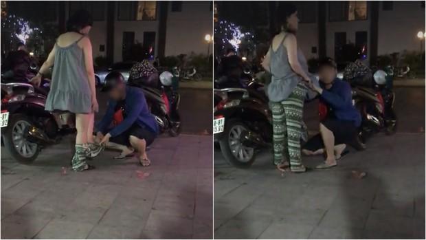 Anh chồng cẩn thận mặc quần cho vợ - Ảnh cắt từ clip