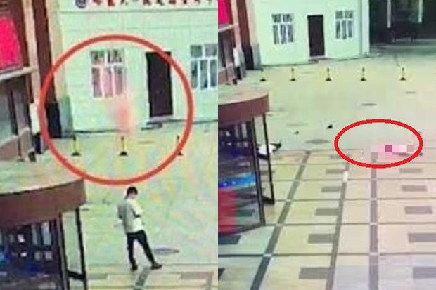 Đang đứng nghịch điện thoại, thanh niên bị người phụ nữ nhảy lầu tự tử rơi trúng - Ảnh 1.