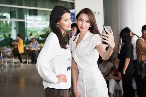 Đương kim Hoa hậu Quốc tế mặc giản dị, khoe nhan sắc nghiêng nước nghiêng thành tại sân bay Việt Nam - Ảnh 6.