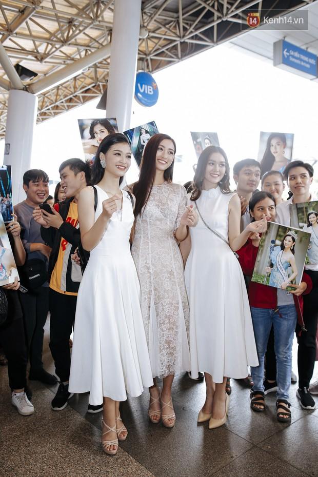 Tân Hoa hậu Lương Thùy Linh mặc giản dị, rạng rỡ cùng 2 Á hậu xuất hiện tại TP.HCM trong vòng tay người hâm mộ - Ảnh 18.