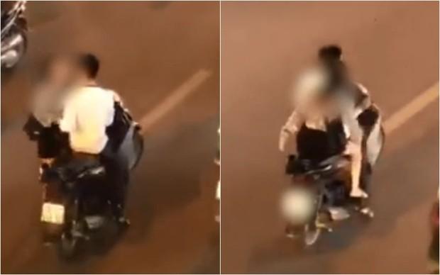 Clip: Đôi nam nữ gây bức xúc khi không đội mũ bảo hiểm, dừng xe máy giữa đường phố để... cãi nhau - Ảnh 2.