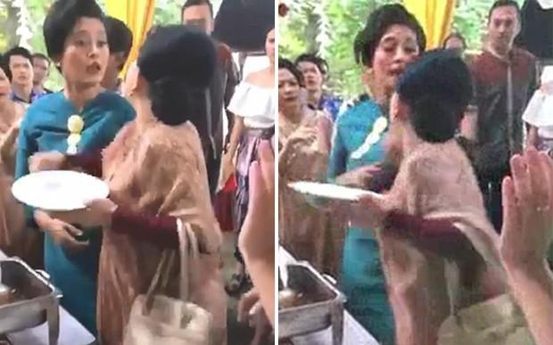 Ăn mặc sang trọng đi ăn cưới, 2 người phụ nữ cãi nhau ỏm tỏi chỉ vì tị nạnh ai gắp nhiều miếng hơn - Ảnh 2.