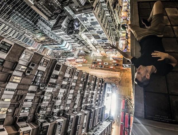 Leo lên loạt tòa nhà cao nhất Hong Kong để chụp hình sống ảo, chàng trai bị dân mạng chỉ trích: Chán sống rồi hả? - Ảnh 9.
