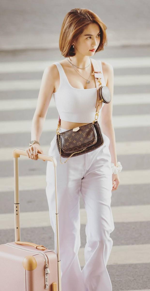 Đu trend nhanh như Ngọc Trinh: Vừa sắm túi giống Địch Lệ Nhiệt Ba đã độ túi độc như Lisa - Ảnh 1.