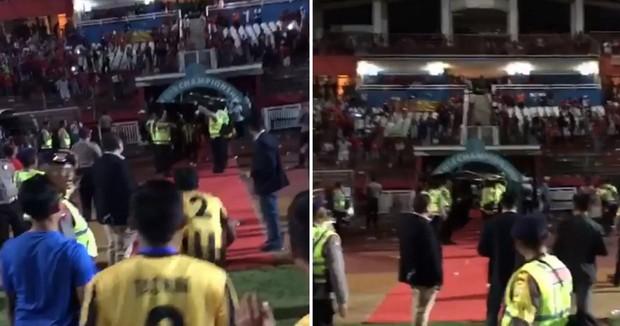 Bạo loạn trận Indonesia - Malaysia: fan chủ nhà ném đá, xô xát với nhóm CĐV đội khách - Ảnh 3.