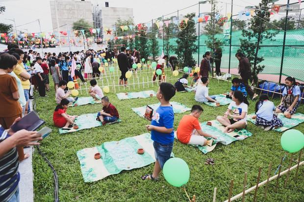 Ảnh: Hàng ngàn trẻ em nghèo ở Sài Gòn làm đèn ông sao đón Tết trung thu sớm - Ảnh 3.