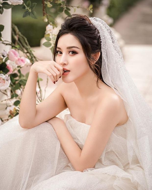 Huyền My tung loạt ảnh hoá cô dâu cực lộng lẫy nhưng khuôn mặt ngày càng khác lạ sau 5 năm đăng quang Á hậu 1 mới gây chú ý! - Ảnh 4.