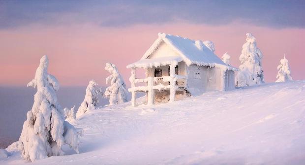 Chùm ảnh mùa đông băng tuyết trắng xóa phủ khắp vạn vật đẹp đến mê hồn, trông như khung cảnh trong truyện cổ tích - Ảnh 15.