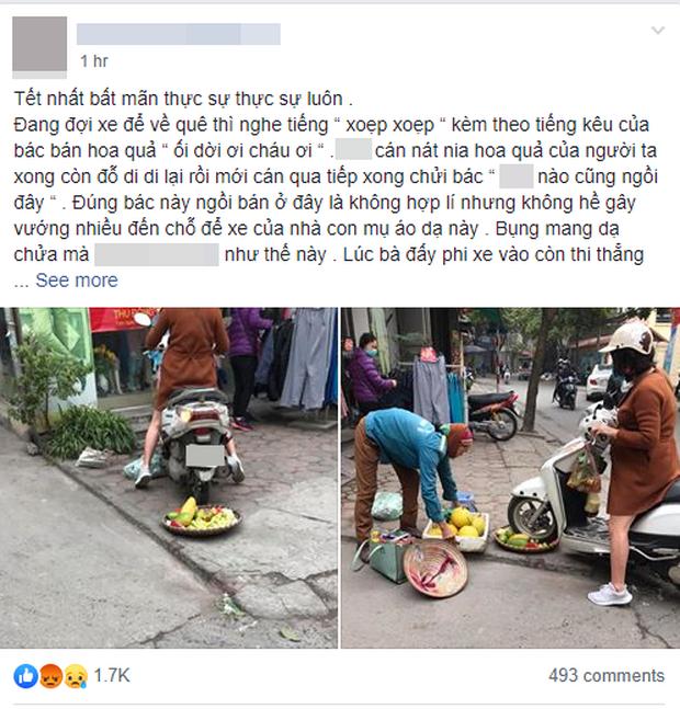 Phẫn nộ hình ảnh người phụ nữ mang bầu lái xe máy cán thẳng qua nia trái cây của cô bán hàng rong ven đường vì ngồi chắn trước cửa hàng - Ảnh 1.