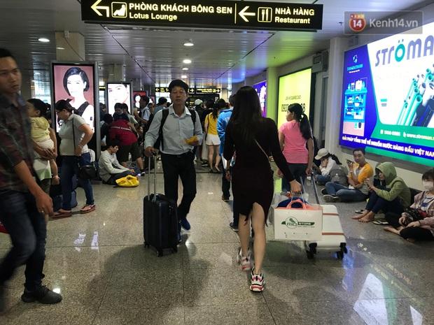 Sân bay Tân Sơn Nhất vỡ trận, hàng nghìn người rồng rắn xếp hàng dài, nằm ngồi vạ vật chờ giờ check in về quê đón Tết - Ảnh 13.