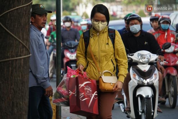 Sài Gòn ùn tắc khắp các ngả đường, Hà Nội vắng vẻ do người dân tranh thủ về quê ăn Tết từ trước - Ảnh 18.