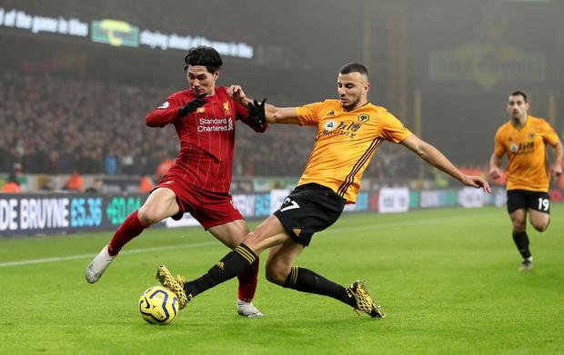 Xé lưới Wolves ở những phút cuối cùng, Firmino giúp Liverpool giữ vững ngôi đầu bảng Ngoại hạng Anh - Ảnh 4.