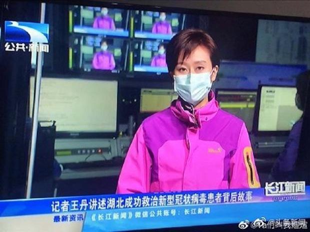 Lo sợ Virus Corona nguy hiểm, các MC và phóng viên ở ổ dịch Vũ Hán cũng phải đeo khẩu trang khi lên hình - Ảnh 2.