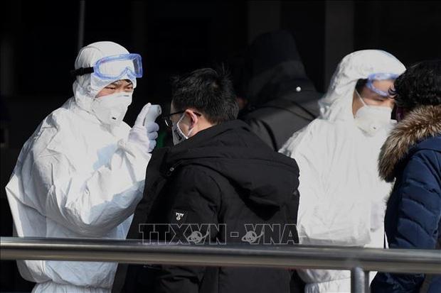 Dịch bệnh viêm phổi do virus corona: Người Việt vẫn an toàn trong tâm dịch tại Trung Quốc - Ảnh 1.