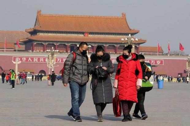Tình hình đón Tết ở Trung Quốc giữa đại dịch: Đền chùa, khu vui chơi bị đóng cửa, giao thông ngừng hoạt động...thành phố vắng như bị bỏ hoang - Ảnh 3.