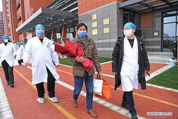Trung Quốc: Bệnh nhân nhiễm virus corona đầu tiên xuất viện - Ảnh 5.