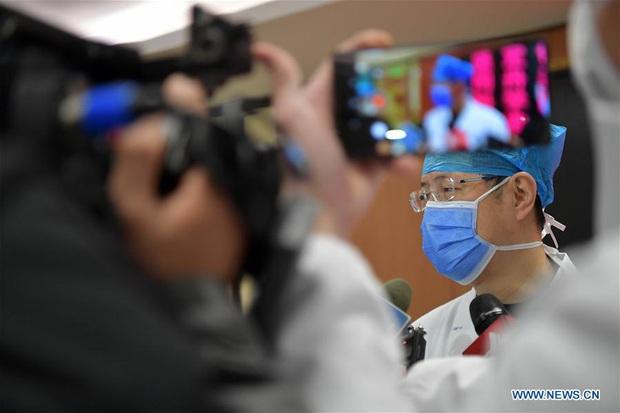 Trung Quốc: Bệnh nhân nhiễm virus corona đầu tiên xuất viện - Ảnh 7.