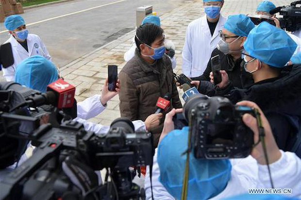 Trung Quốc: Bệnh nhân nhiễm virus corona đầu tiên xuất viện - Ảnh 6.