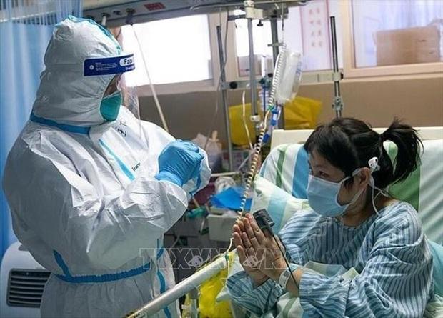 Trung Quốc cho phép WHO cử chuyên gia đến nghiên cứu về chủng virus corona mới  - Ảnh 1.
