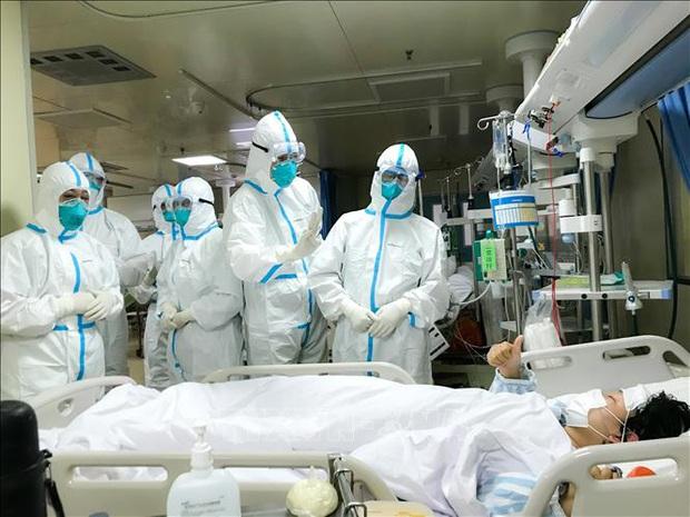 Virus Corona có thể lây từ người sang người trong vòng 15 phút - Ảnh 1.