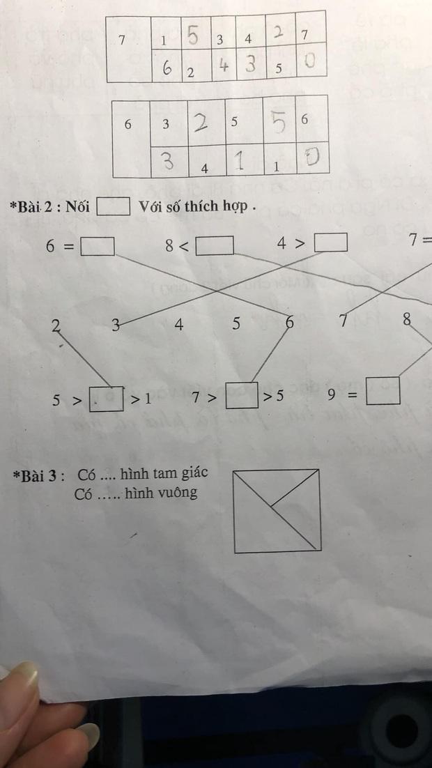 Con gái đếm 4 tam giác nhưng bị gạch sai, người mẹ thắc mắc giáo viên liền nhận về lời giải tâm phục khẩu phục - Ảnh 1.
