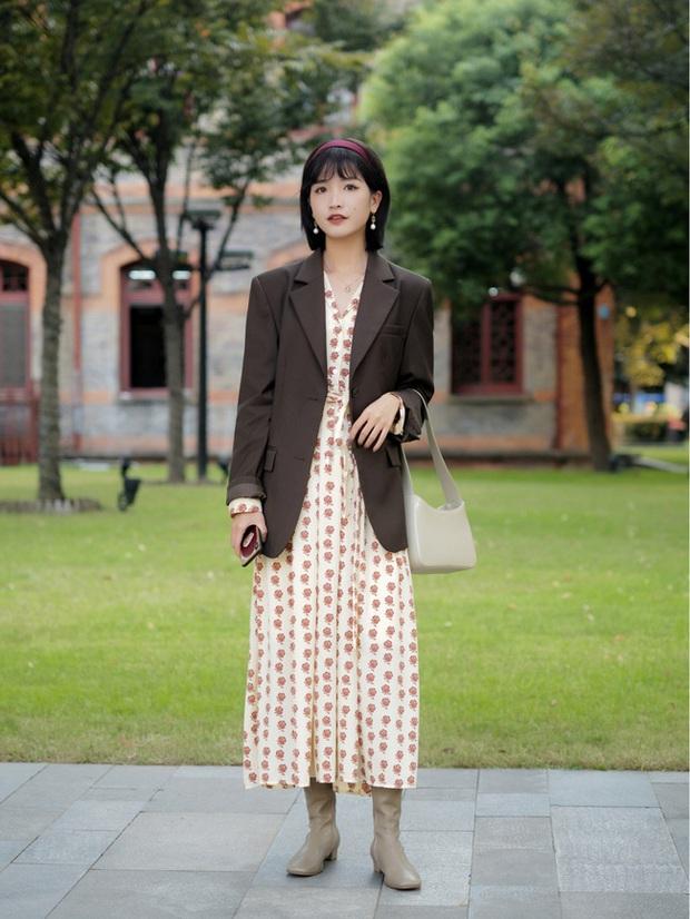 Street style châu Á: Hội chị em lên đồ đẹp hút mắt, toàn blazer và cardigan nhưng nhìn sang hết nấc - Ảnh 1.