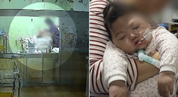 Em bé nhắm nghiền mắt trong sinh nhật đầu tiên tưởng như ngủ nhưng là kết quả của hành vi bạo hành bởi y tá gây chấn động Hàn Quốc 1 năm trước - Ảnh 3.