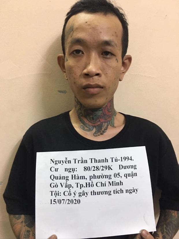 Truy nã gã thợ xăm đánh chém người ở Sài Gòn - Ảnh 1.
