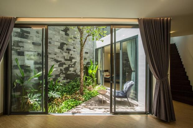 Nằm sâu trong con ngõ nhỏ Hội An, ngôi nhà vẫn ngập tràn nắng gió bởi tư duy thiết kế khoa học của kiến trúc sư - Ảnh 6.