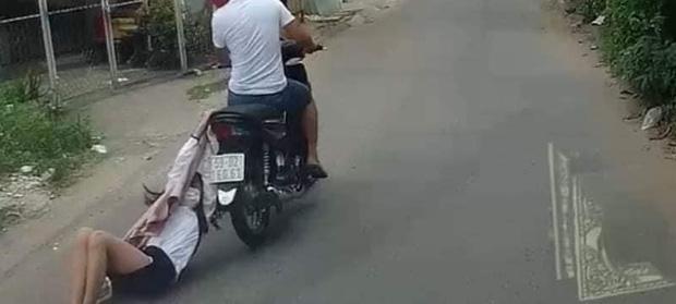 Clip tên cướp kéo lê cô gái hàng trăm mét trên đường phố Sài Gòn gây phẫn nộ - Ảnh 2.