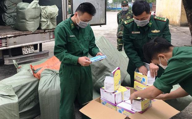 Nam thanh niên thuê người vận chuyển 50.000 khẩu trang sang Trung Quốc bán kiếm lời - Ảnh 1.