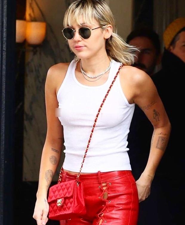 Miley Cyrus thả rông táo bạo tại sự kiện nhưng dân tình chỉ dán mắt vào đôi chân thon nuột nà của cô nàng - Ảnh 1.