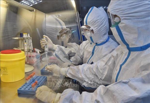 Trung Quốc phát triển bộ xét nghiệm nCoV cho kết quả trong 15 phút - Ảnh 1.