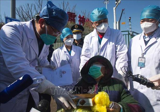 Trung Quốc công bố số liệu mới về tổng số ca khỏi bệnh và xuất viện - Ảnh 1.